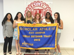 Sana, Sarah, Katie, Leigh, Namita and Ashley hold the Championship Banner