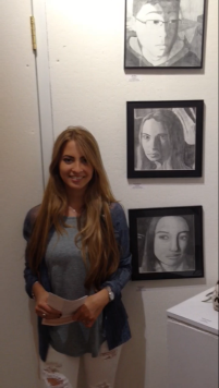 Julia Mongelluzzo with her graphite self-portrait