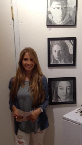 Julia Mongelluzzo with her graphite self-portrait